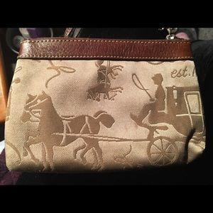 Coach wristlet with equestrian theme